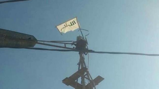 """رفع علم """" داعش """" بأعلى بناية يوقف شخصا في بلفاع"""